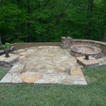 Fire Pit in a Hill, Retaining wall, Water Feature and lights.