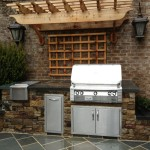 Outdoor kitchen, arbor,and small water feature