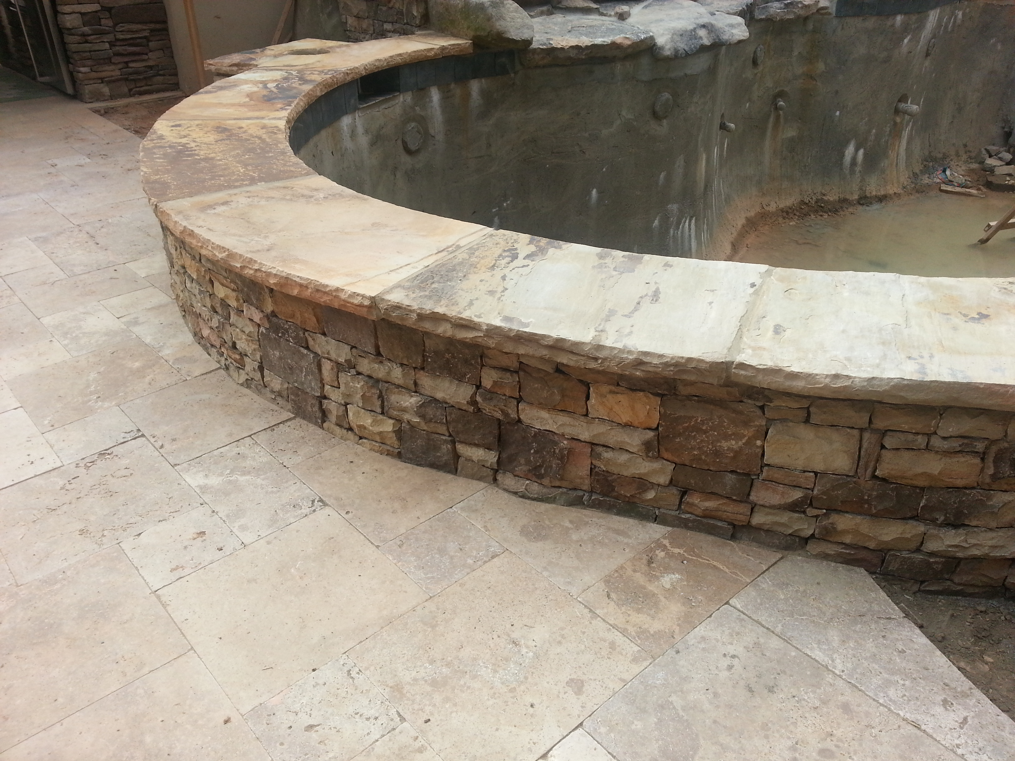 Stone fish pond forsyth landscape for Stone koi pond